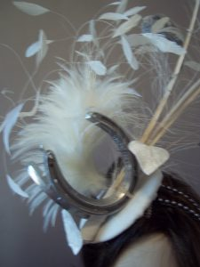 Breeder's Cup fascinator featuring horse shoes.
