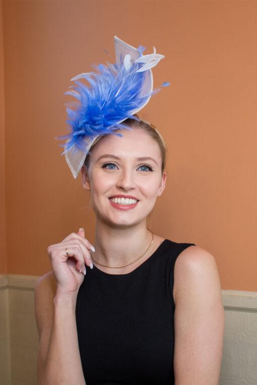 Stephanie Kwolek white and blue fascinator